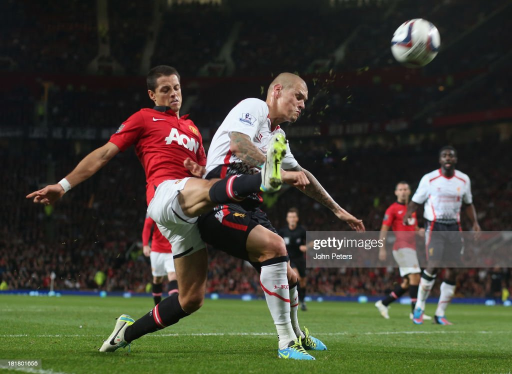 Javier 'Chicharito' Hernandez of Manchester United in action with <a gi-track='captionPersonalityLinkClicked' href=/galleries/search?phrase=Martin+Skrtel&family=editorial&specificpeople=5554576 ng-click='$event.stopPropagation()'>Martin Skrtel</a> of Liverpool during the Capital Cup Third Round match between Manchester United and Liverpool at Old Trafford on September 25, 2013 in Manchester, England.
