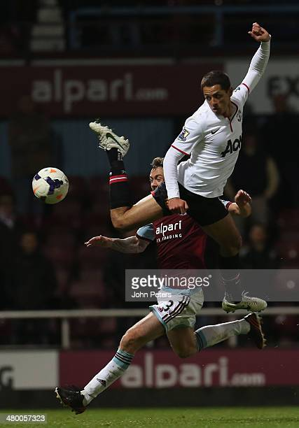 Javier 'Chicharito' Hernandez of Manchester United in action with George McCartney of West Ham United during the Barclays Premier League match...