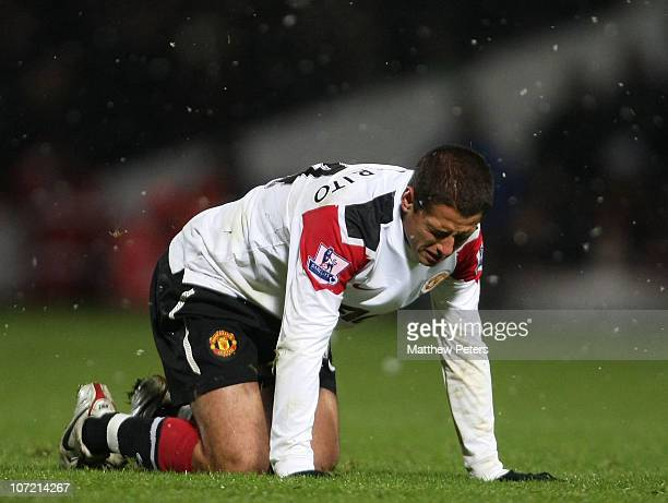 Javier 'Chicharito' Hernandez of Manchester United lies injured during the Carling Cup quarterfinal match between West Ham United and Manchester...