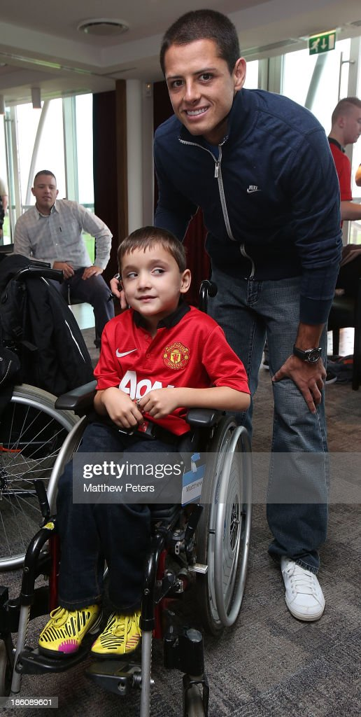 Javier 'Chicharito' Hernandez of Manchester United meets Matthew Townrow at a Manchester United Foundation Dream Day, for fans with life-limiting illnesses, at Aon Training Complex on October 28, 2013 in Manchester, England.
