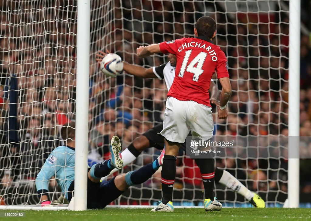 Javier 'Chicharito' Hernandez of Manchester United scores their second goal during the Capital One Cup Fourth Round match between Manchester United and Norwich City at Old Trafford on October 29, 2013 in Manchester, England.