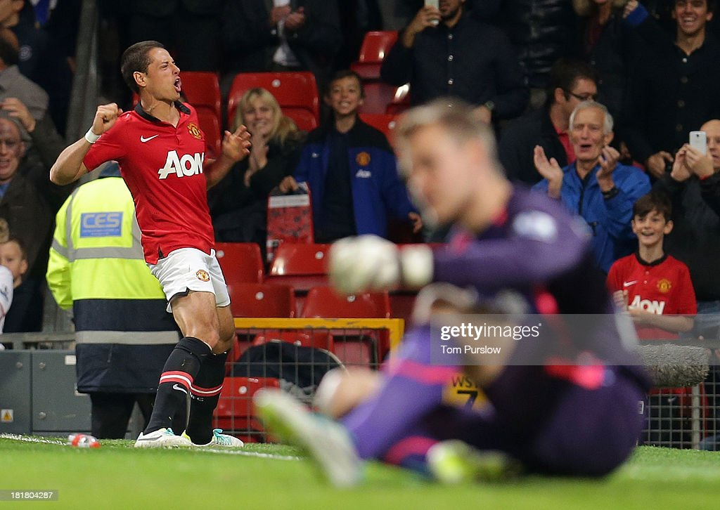 Javier 'Chicharito' Hernandezof Manchester United celebrates scoring their first goal during the Capital One Cup Third Round match between Manchester United and Liverpool at Old Trafford on September 25, 2013 in Manchester, England.