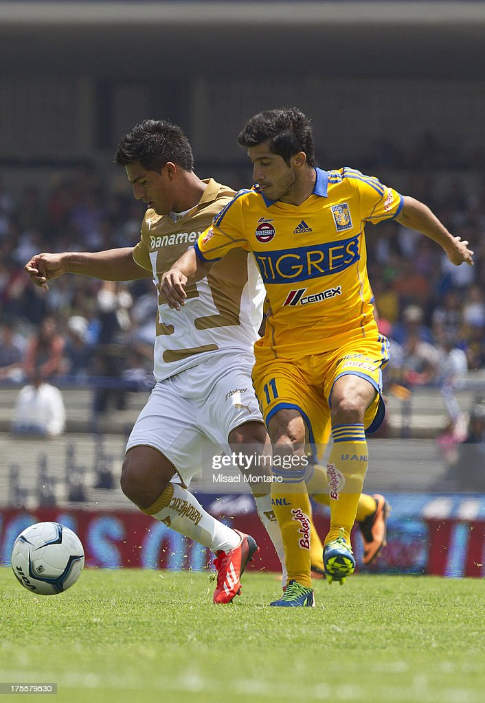 Javier Cortes fights for the ball with Tigres´ Damian Alvarez during a match between Pumas and Tigres as part of Torneo Apertura of Liga MX 2013 ar Olympic Stadium on August 04, 2013 in Mexico City, Mexico.