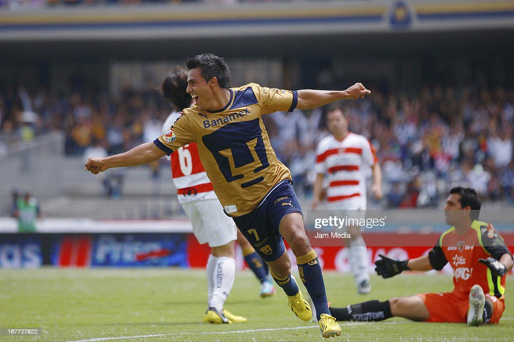 Javier Cortes of Pumas celebrates score a goal against Jaguares during the match as part of the Clausura 2013 Liga MX at Olimpico Stadium on April 28, 2013 in Mexico City, Mexico.