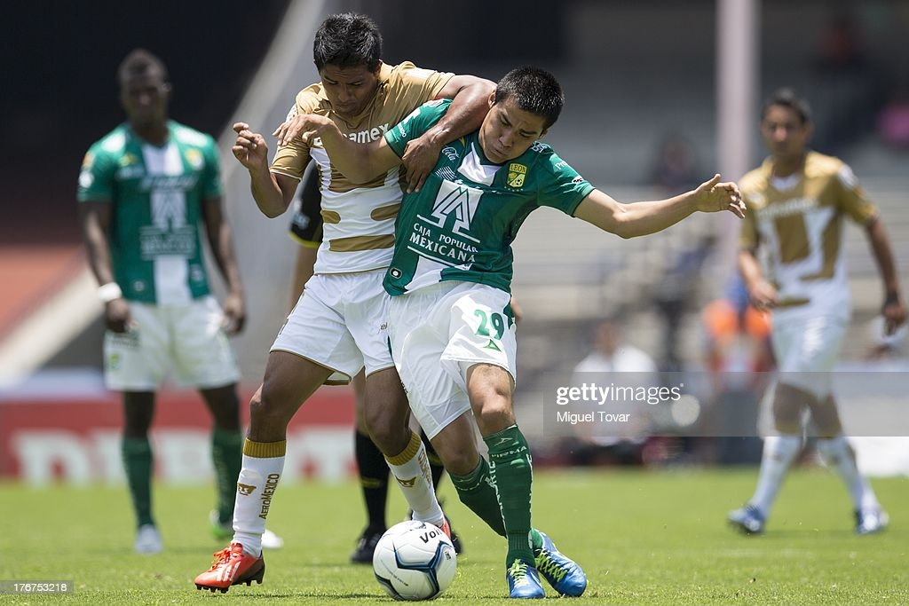Javier Cortes of Pumas fights for the ball with Aldo Rocha of Leon during a match between Pumas and Leon as part of the Apertura 2013 Liga MX at Olympic stadium, on August 18, 2013 in Mexico City, Mexico.