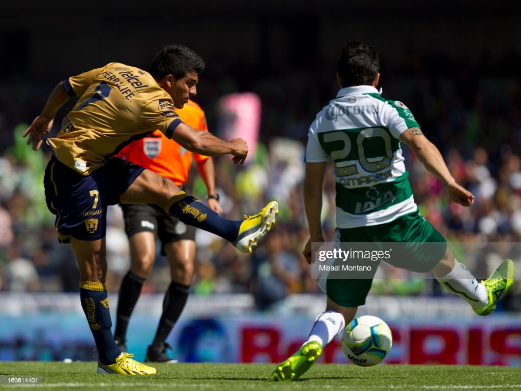 Javier Cortes of Pumas fights for the ball with Osmar Mares of Santos during a match between Pumas and Santos as part of the Clausura 2013 at Olímpico Stadium on February 03, 2013 in Mexico City, Mexico.