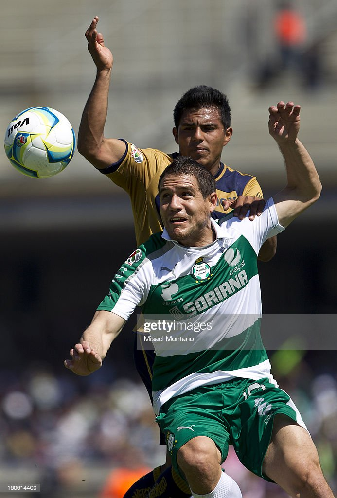 Javier Cortes of Pumas fights for the ball with Rafael Figueroa of Santos during a match between Pumas and Santos as part of the Clausura 2013 at Olímpico Stadium on February 03, 2013 in Mexico City, Mexico.