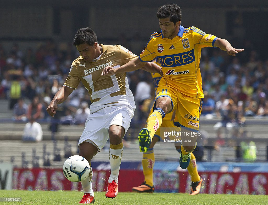 Javier Cortes of Pumas , fights for the ball with Tigres´ Damian Alvarez during a match between Pumas and Tigres as part of Torneo Apertura of Liga MX 2013 ar Olympic Stadium on August 04, 2013 in Mexico City, Mexico.