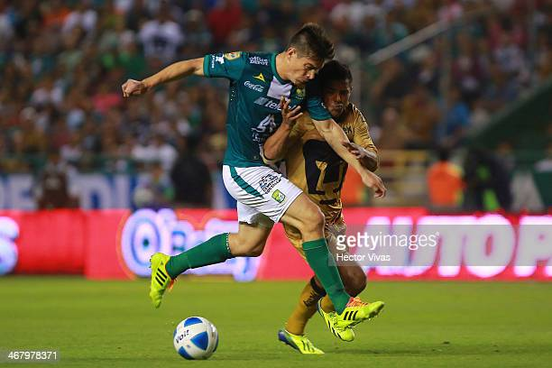 Javier Cortes of Pumas struggles for the ball with Ignacio Gonzalez of Leon during a match between Leon and Pumas UNAM as part of the Clausura 2014...