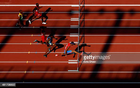 Javier Culson of Puerto Rico leads the field on his way to a second place win in the men's 400 meter hurdles final during Day 13 of the Toronto 2015...