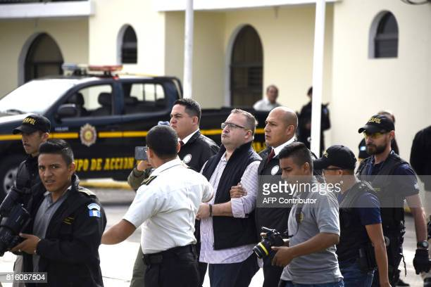 Javier Duarte former governor of the Mexican state of Veracruz is taken under custody to board an aircraft to be extradited to Mexico in Guatemala...