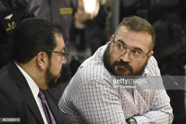 Javier Duarte former governor of the Mexican state of Veracruz accused of graft and involvement in organized crime listens to his lawyer as he...