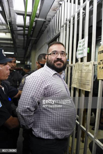 Javier Duarte former governor of the Mexican state of Veracruz accused of graft and involvement in organized crime is escorted by police officers...
