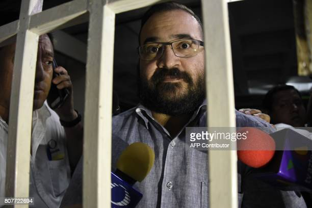 Javier Duarte former governor of the Mexican state of Veracruz accused of graft and involvement in organized crime is escorted by police officers for...