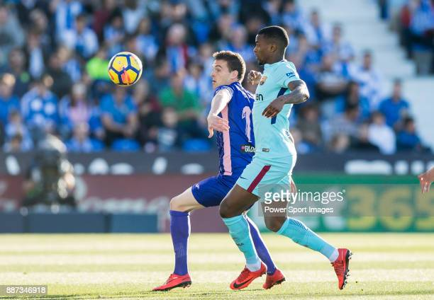 Javier Eraso Goni of CD Leganes fights for the ball with Nelson Cabral Semedo of FC Barcelona during the La Liga 201718 match between CD Leganes vs...