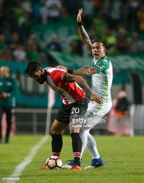 Javier Fabian Toledo of Estudiantes defends the ball as Dayro Moreno of Atletico Nacional complaints during a group stage match between Estudiantes...