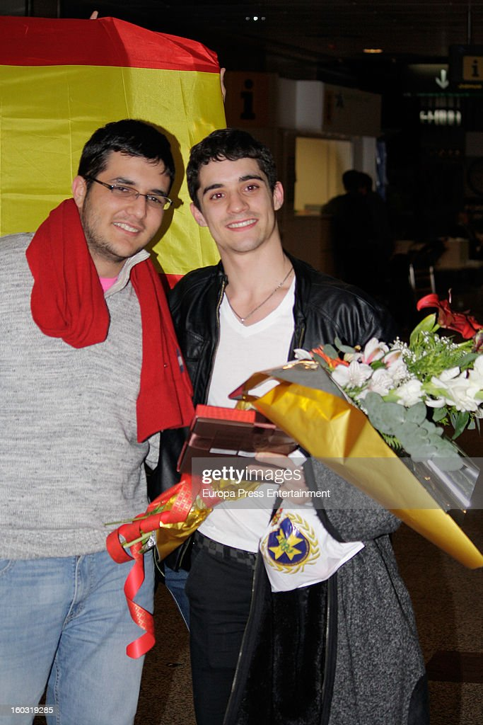 Javier Fernandez (R) is seen arriving at Spain after winning the title as The 2013 European Figure Skating Championships 2013 in Zagreb on January 28, 2013 in Madrid, Spain.