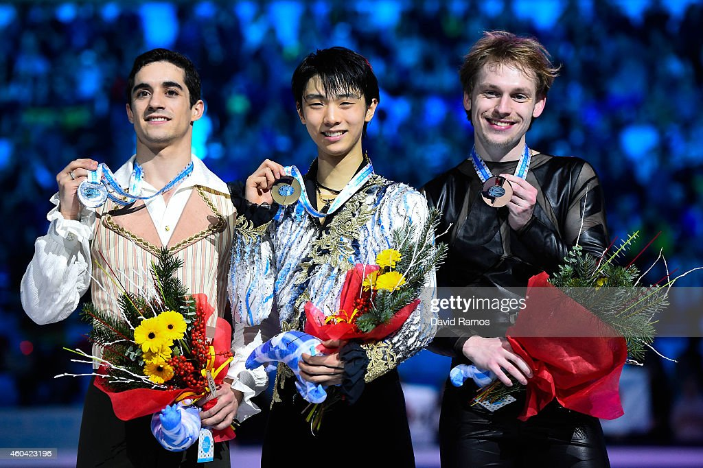 Javier Fernandez (L) of Spain and Yuzuru Hanyu (C) of Japan and Sergei Voronov of Russia pose for the media during the medals ceremony during day three of the ISU Grand Prix of Figure Skating Final 2014/2015 at Barcelona International Convention Centre on December 13, 2014 in Barcelona, Spain.