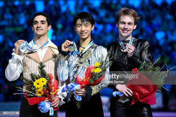 Javier Fernandez of Spain and Yuzuru Hanyu of Japan and Sergei Voronov of Russia pose for the media during the medals ceremony during day three of...