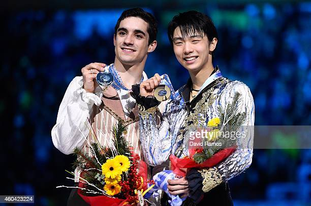 Javier Fernandez of Spain and Yuzuru Hanyu of Japan pose for the media during the medals ceremony during day three of the ISU Grand Prix of Figure...