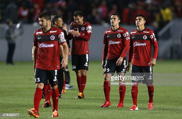 Javier Gandolfi Javier Guemez Herculez Gomez and Joe Corona of Club Tijuana look on after losing the first match of two in their CONCACAF Champions...