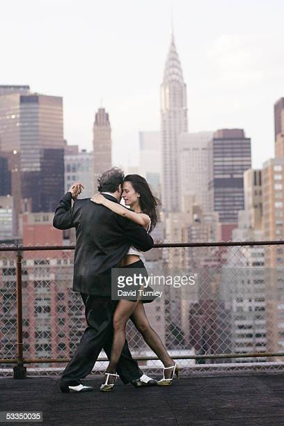 Javier Garcia and Moira Sauvane dance the tango on a Manhattan rooftop June 17 2005 in New York City Javier Garcia an ArgentinianAmerican and a...
