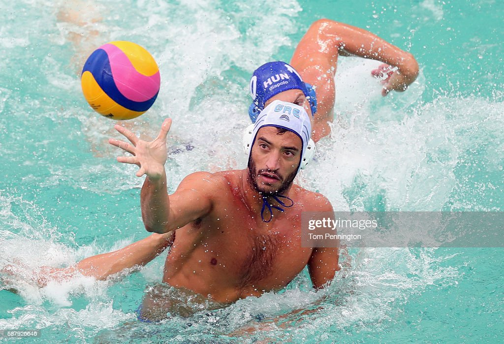 Javier Garcia Gadea of Greece passes the ball against Denes Varga of Hungary during Men's Preliminary Round Group A Match 14 Greece vs Hungary at the...