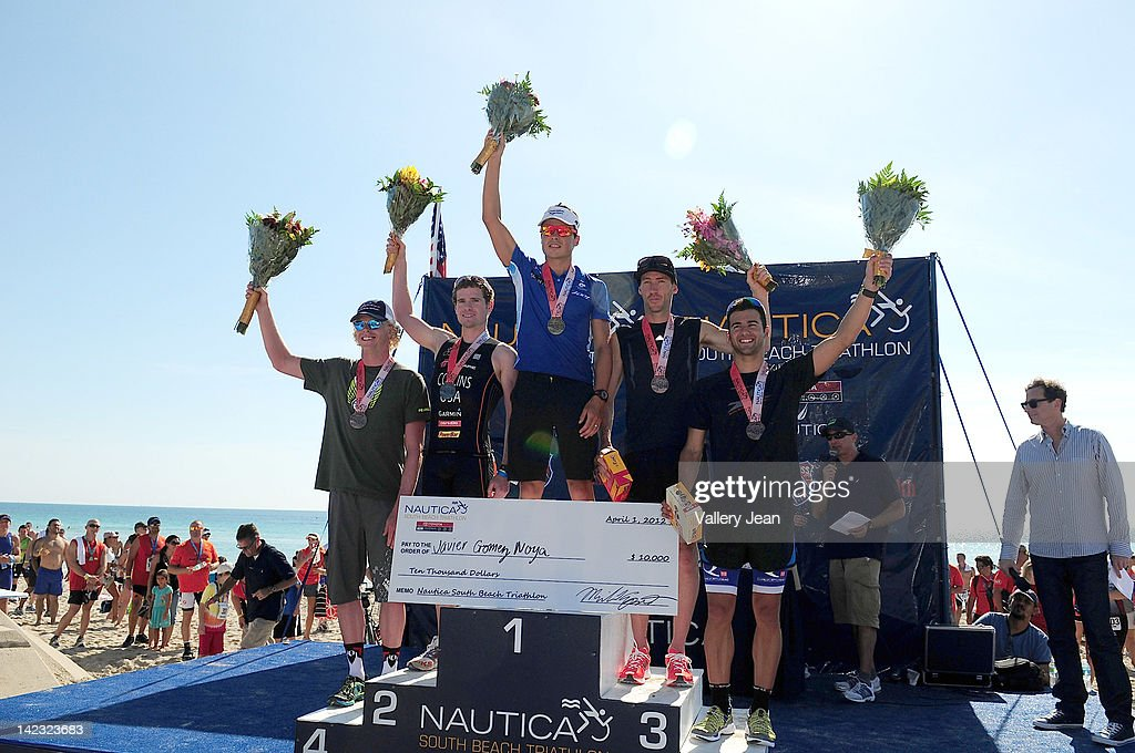Javier Gomez Noya (C) participates in the 5th Annual Nautica South Beach Triathlon to benefit St. Jude Children's Research Hospital on April 1, 2012 in Miami Beach, Florida.