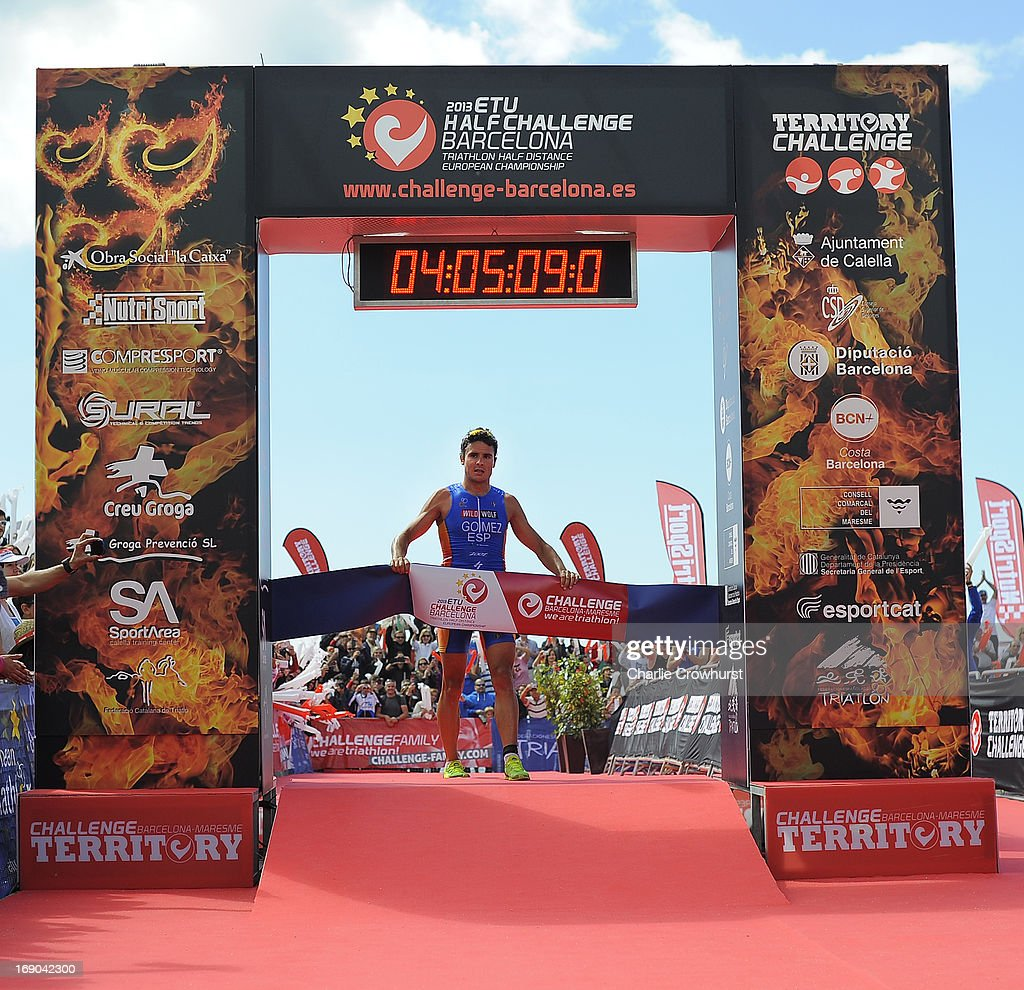 Javier Gomez of Spain crosses the line first during the Challenge Family Triathlon Barcelona on May 19, 2013 in Barcelona, Spain.