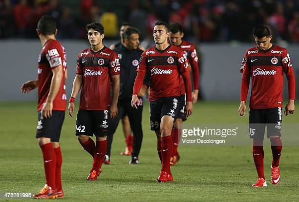 Javier Guemez Herculez Gomez and Joe Corona of Club Tijuana look on after losing the first match of two in their CONCACAF Champions League...