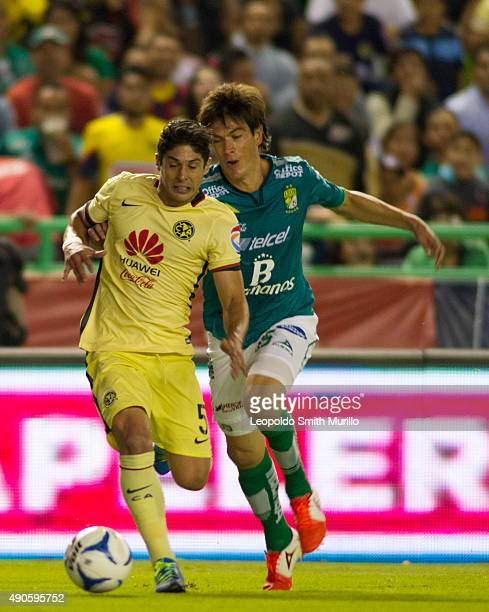 Javier Guemez of America fights for the ball with Ignacio Gonzalez of Leon during the 11th round match between Leon and America as part of the...