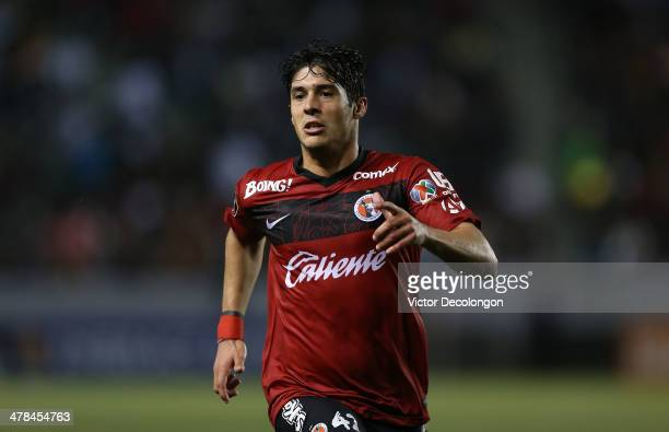Javier Guemez of Club Tijuana pursues the play during the CONCACAF Champions League Quarterfinal match against the Los Angeles Galaxy at StubHub...