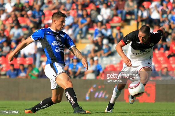 Javier Guemez of Queretaro fights for the ball with Eduardo Tercero of Lobos BUAP during the 2nd round match between Queretaro and Lobos BUAP as part...