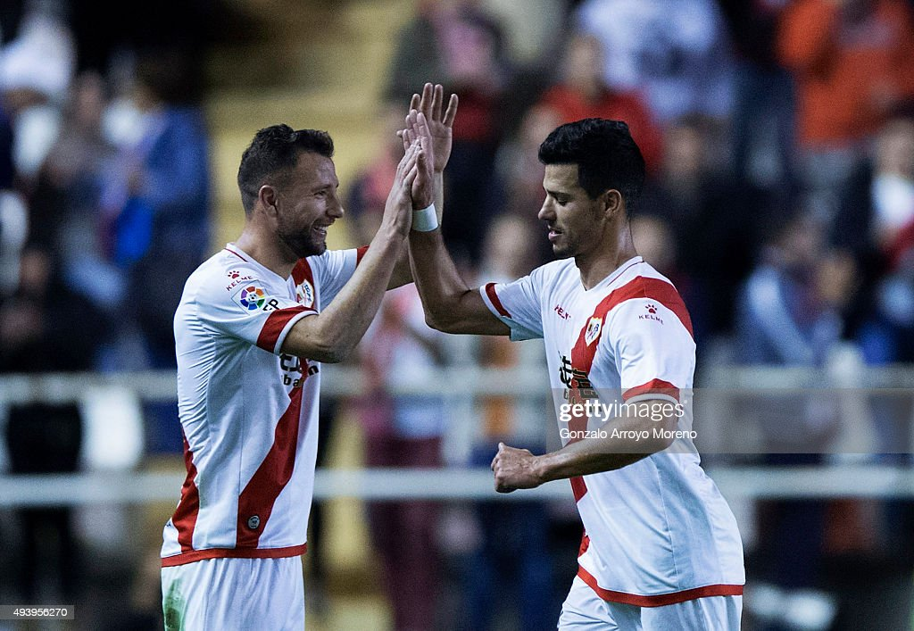 Javier Guerra (R) of Rayo Vallecano de Madrid clashes hands with his teammate <a gi-track='captionPersonalityLinkClicked' href=/galleries/search?phrase=Razvan+Rat&family=editorial&specificpeople=2147212 ng-click='$event.stopPropagation()'>Razvan Rat</a> as he leaves the pitch during the La Liga match between Rayo Vallecano de Madrid and RCD Espanyol at Estadio de Vallecas on October 23, 2015 in Madrid, Spain.