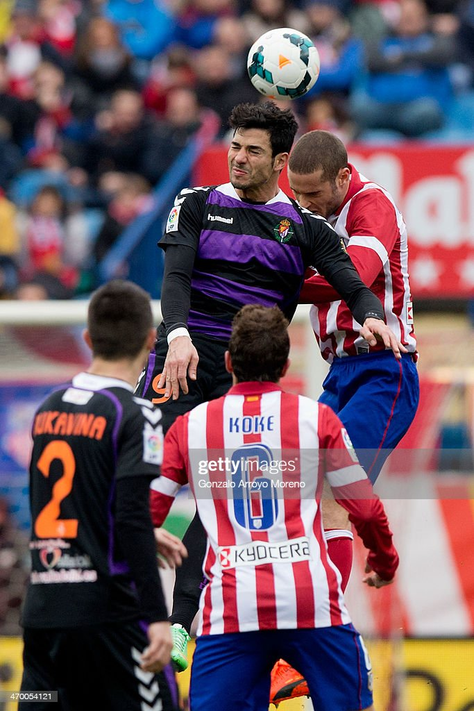 Javier Guerra of Real Valladolid CF wins the header after Mario Suarez of Atletico de Madrid during the La Liga match between Club Atletico de Madrid and Real Valladolid CF at Vicente Calderon Stadium on February 15, 2014 in Madrid, Spain.