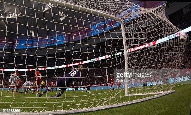 Javier Herhandez of Mexico scores a goal against goalkeeper Milan Borjan of Canada during FIFA 2018 World Cup Qualifier soccer action at BC Place on...