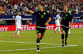 Javier Hernandez and Andres Guardado of Mexico celebrate their first goal during the first half of an international friendly match between Argentina...