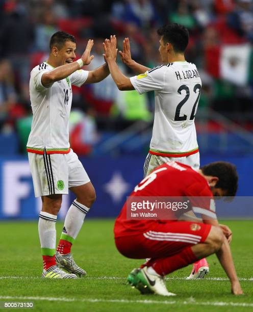 Javier Hernandez and Hirving Lozano of Mexico celebrate their 21 victory while Georgy Dzhikya of Russia shows dejection after the FIFA Confederations...