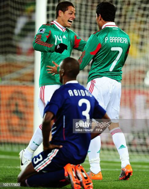 Javier Hernandez and Pablo Barrera celebrate after Eric Abidal of France fould Barrera on his way to the goal and the referee decided on penalty...