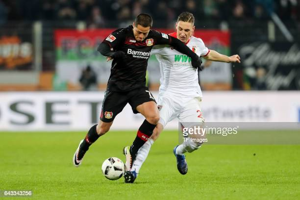Javier Hernandez Balcazar of Leverkusen und Dominik Kohr of Augsburg battle for the ball during the Bundesliga match between FC Augsburg and Bayer 04...