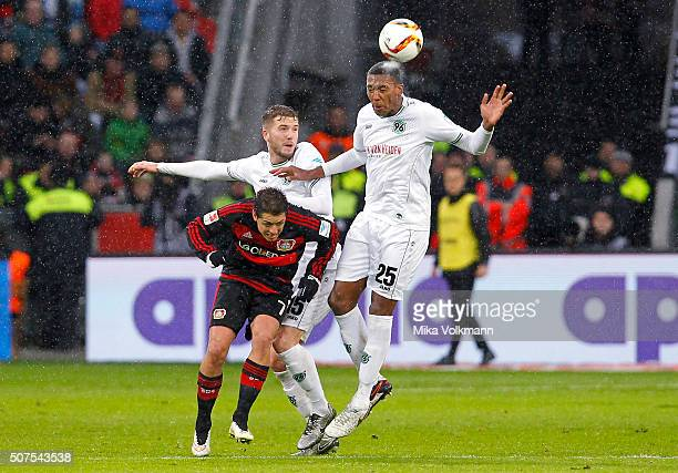Javier Hernandez Chicharito of Leverkusen fights against Marcelo of Hannover and Andre Hoffmann of Hannover during the Bundesliga match between Bayer...