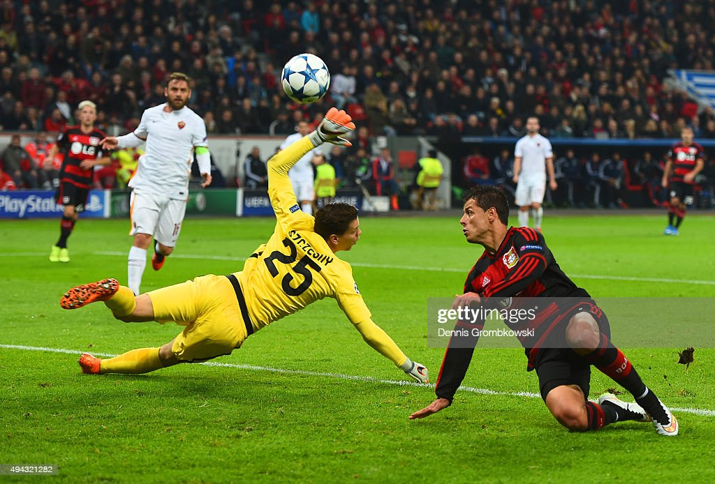 Javier Hernandez of Bayer Levekusen beats goalkeeper Wojciech Szczesny of AS Roma to score their second goal during the UEFA Champions League Group E...