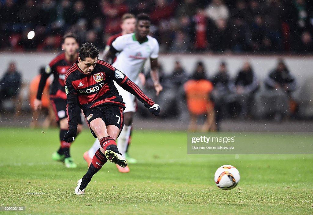 Javier Hernandez of Bayer Leverkusen scores their first goal from the penalty spot during the DFB Cup Quarter Final match between Bayer Leverkusen...