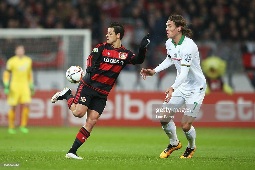 Javier Hernandez of Bayer Leverkusen takes on Jannik Vestergaard of Werder Bremen during the DFB Cup Quarter Final match between Bayer Leverkusen and Werder Bremen at BayArena on February 9, 2016 in Leverkusen, Germany.