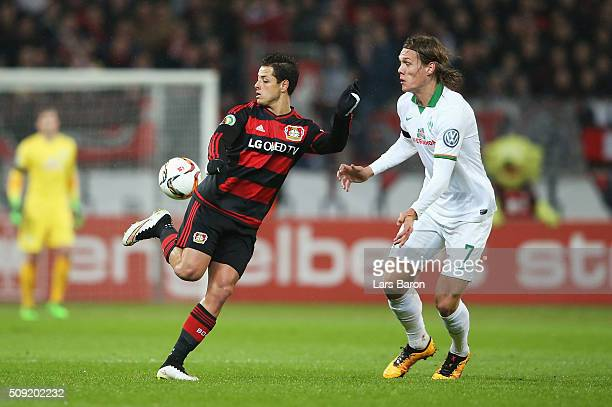 Javier Hernandez of Bayer Leverkusen takes on Jannik Vestergaard of Werder Bremen during the DFB Cup Quarter Final match between Bayer Leverkusen and...