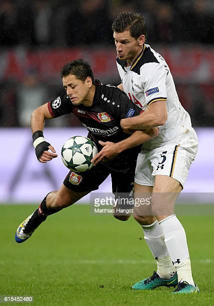Javier Hernandez of Leverkusen and Jan Vertonghen of Tottenham battle for the ball during the UEFA Champions League group E match between Bayer 04...