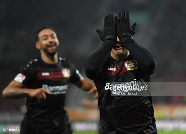 Javier Hernandez of Leverkusen celebrates scoring the second goal with Karim Bellarabi during the Bundesliga match between FC Augsburg and Bayer 04...