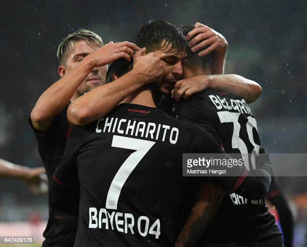 Javier Hernandez of Leverkusen celebrates scoring the second goal with teamates during the Bundesliga match between FC Augsburg and Bayer 04...