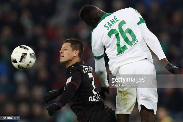 Javier Hernandez of Leverkusen is challenged by Ludovic Lamine Sane of Bremen during the Bundesliga match between Bayer 04 Leverkusen and Werder...