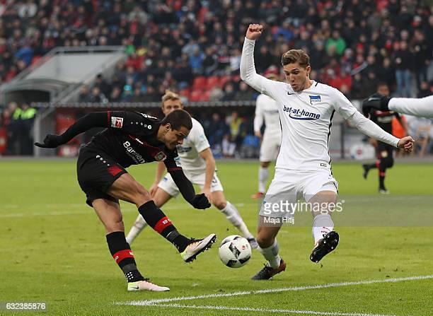 Javier Hernandez of Leverkusen is challenged by Niklas Stark of Berlin during the Bundesliga match between Bayer 04 Leverkusen and Hertha BSC at...